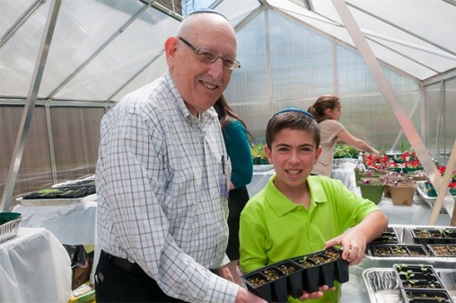 Harold Kestenbaum in the Hebrew Academy of Morris County greenhouse