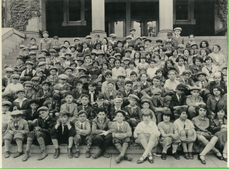 Boys and girls sit on the steps of the Cincinnati Talmud Torah Society School