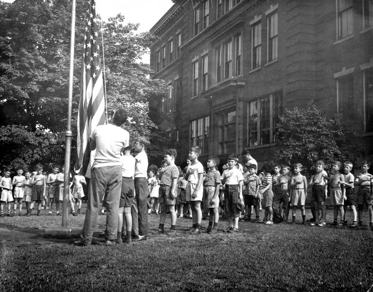 A historical photo of campers at Cincinnati's JCC raising the U.S. flag