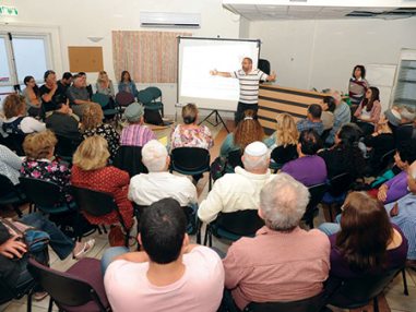 Group of people at a lecture- Academy in Town Square in Israel