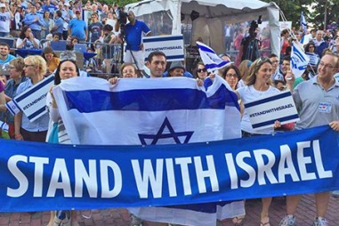Group of People Holding Israeli Flag - JFC-UIA 2015 Annual Report