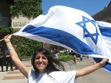 cija advocacy - young woman holding israeli flag